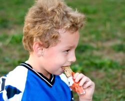 kid eating a granole bar