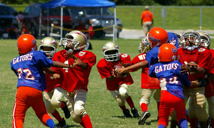 Study tackles brain function and head impacts in youth football