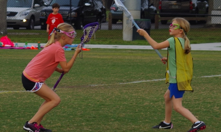 Bring patience, a smile and a team-first attitude to your lacrosse practices